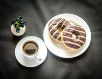 Chocolate donuts with a cup of coffee Stock Photos