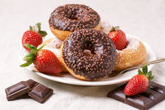 Chocolate donuts with fresh strawberries Royalty Free Stock Photos