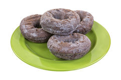 Chocolate donuts on green plate Stock Image