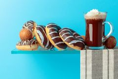 Chocolate donuts and hot chocolate with cream royalty free stock photo