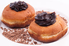 Chocolate donuts  isolated on a white plate Royalty Free Stock Images