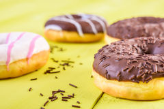 Chocolate Donuts On Yellow Background Royalty Free Stock Photos