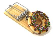 Chocolate doughnut with sprinkles, like bait, in wooden mousetrap Stock Images
