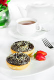Chocolate doughnut and tea Stock Images