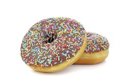 Chocolate doughnuts with coloured sprinkles Royalty Free Stock Images