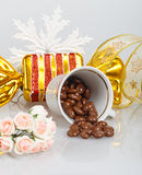 Chocolate dragees in an inverted cup with decoration Stock Photos