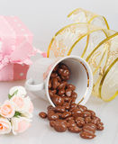Chocolate dragees in an inverted cup with decoration Stock Photo