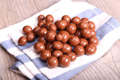Chocolate drazee on the table. Chocolate drazee with nuts on the table Royalty Free Stock Images