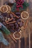 Chocolate with dried orange and cinnamon. Chocolate with dried orange,cinnamon and fir branches Stock Photography