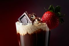 Chocolate drink with whipped cream, strawberry and pieces of black chocolate stock images