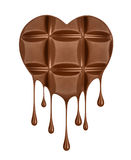 Chocolate dripping from chocolate bar in the shape of heart Royalty Free Stock Photo