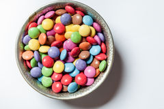Chocolate drops in bowl Stock Image