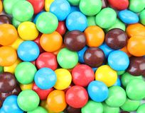 Chocolate drops with bright colored candy coating Stock Images