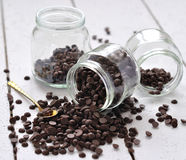 Chocolate drops in a glass jar Royalty Free Stock Photos