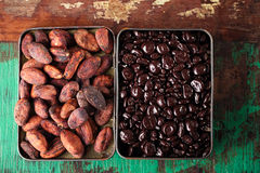 Chocolate drops and roasted cocoa chocolate beans  wood backgrou Stock Images