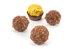 Chocolate drops. On a white background Stock Photos