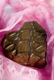 Chocolate e laço imagens de stock