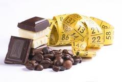 Chocolate e medida imagens de stock royalty free