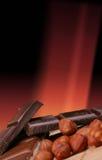 Chocolate e porcas Fotos de Stock Royalty Free