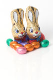 Chocolate easter bunnies. Two easter bunnies made of chocolate surrounded by easter eggs Stock Photography