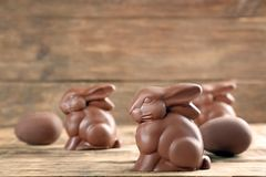 Chocolate Easter bunnies. On wooden background stock photo