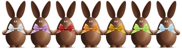 Chocolate Easter bunnies with ribbons bows in various colors on Royalty Free Stock Photography