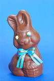 Chocolate easter bunny. Cute tasty chocolate easter bunny with blue background Stock Photo