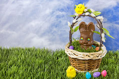 Chocolate Easter bunny in basket Stock Photography