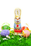 Chocolate easter bunny and colorful eggs on grass Royalty Free Stock Image
