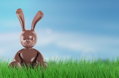 Chocolate easter bunny. 3d render. Chocolate easter bunny. 3 d rendering. On grass Royalty Free Stock Photo