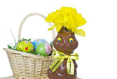 Chocolate Easter bunny with daffodils Royalty Free Stock Photo