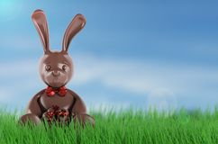 Chocolate easter bunny with eggs and red bow-knot . 3d render. Chocolate easter bunny with eggs and red bow-knot. 3d rendering Stock Photo
