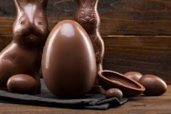 Chocolate Easter bunny, eggs and sweets on rustic background royalty free stock photos