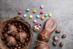 Chocolate Easter bunny and eggs on wooden background Stock Image