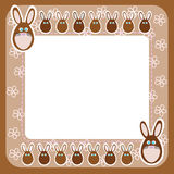 Chocolate Easter bunny on frame with flowers Stock Photography