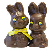 Chocolate Easter Bunny Pair. Chocolate Happy Easter Day Bunny Rabbit Pair with Yellow Ribbon Bow Isolated on White Background Royalty Free Stock Photography
