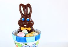 Chocolate Easter Bunny. In a pot of candied eggs Stock Photo