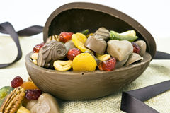 Chocolate Easter Egg. Open chocolate Easter egg full of dried fruits, chocolate candy and nuts stock image