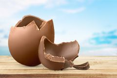 Chocolate easter egg on backgrouund. Easter egg chocolate egg easter fun background colorful stock photography