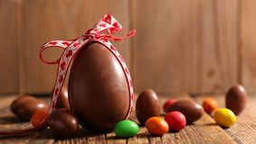 Chocolate easter egg. And bow royalty free stock image