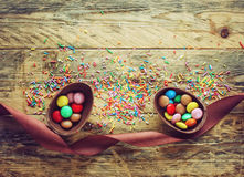 Chocolate Easter egg with candy and ribbon Stock Photos
