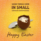 Chocolate Easter egg cream filling on Spring background Stock Photos