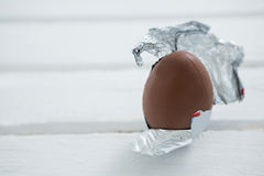 Chocolate Easter egg in foil on white background Stock Photography
