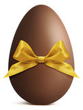 Chocolate Easter Egg with golden ribbon Bow isolated on white ba Stock Photo