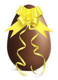 Chocolate Easter Egg with golden ribbon Bow on white ba Stock Images