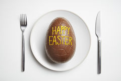 Chocolate easter egg on plate stock photos