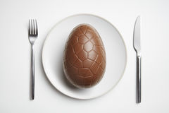 Chocolate easter egg on plate Royalty Free Stock Image