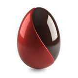Chocolate easter egg with red decoration. On white background - 3d render stock illustration
