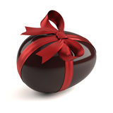 Chocolate easter egg with red ribbon. Isolated on white background Royalty Free Stock Image