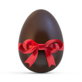 Chocolate easter egg with red ribbon on white Royalty Free Stock Images